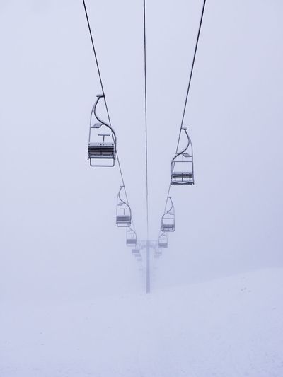 Ski lifts over snowy mountain