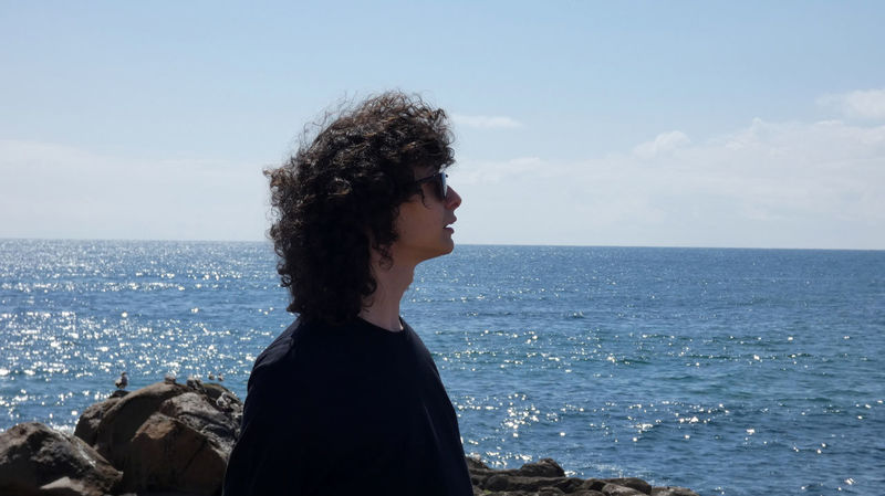 Me and the sea. Man Beauty In Nature Contemplation Curly Hair Day Guy Hair Hairstyle Horizon Horizon Over Water Leisure Activity Lifestyles Looking At View Nature One Person Outdoors Real People Scenics - Nature Sea Sky Standing Water Wind Young Adult Young Women