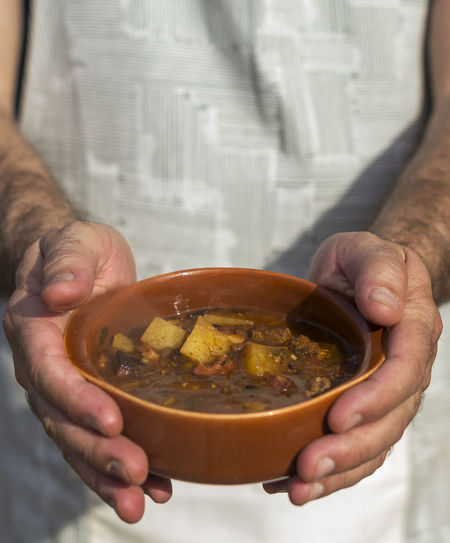 Close-up of man holding bowl