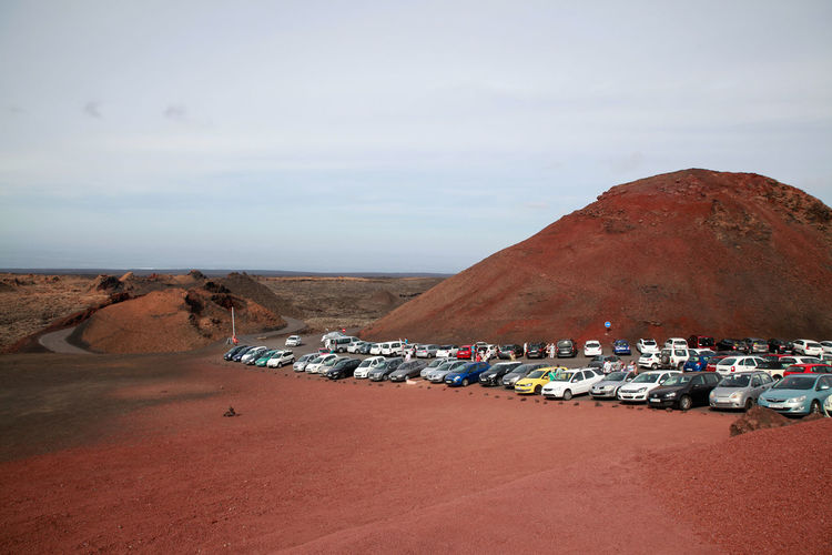 Cars parked by mountain