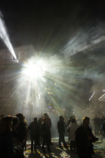 street scene at the festival of lights in Berlin Arts Culture And Entertainment Cities at Night! Crowd Dust Enjoyment Festival Of Lights Fun Group Of People Illuminated Large Group Of People Light And Shadow Night Nightlife People Performance Potsdamer Platz Silhouette Smoke Street Street Photography Street Scene Streetphotography