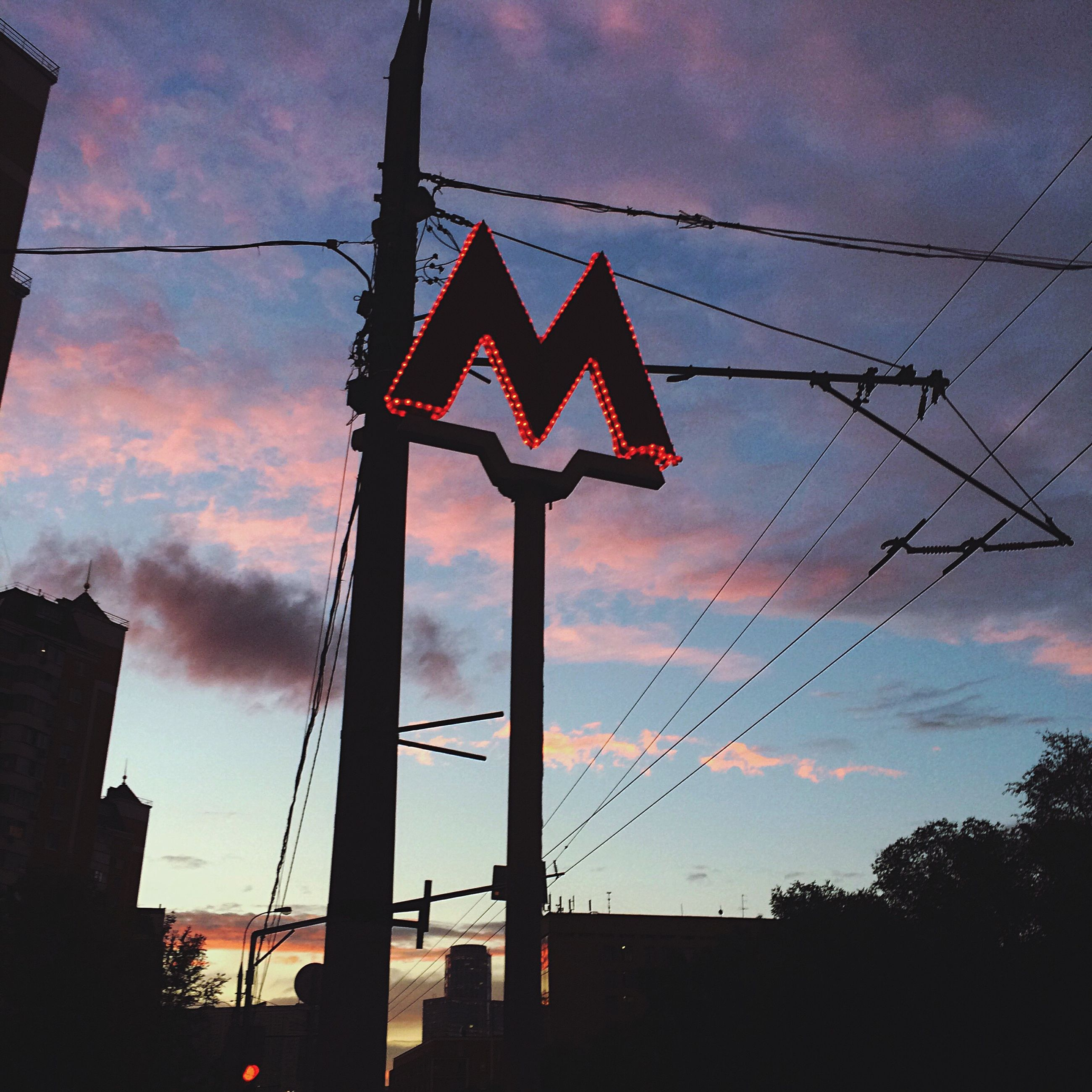 sunset, silhouette, low angle view, sky, cloud - sky, dusk, cloud, development, cable, outdoors, cloudy, power line, blue, outline, red, high section, no people, large, multi colored