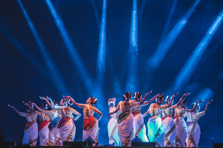 Arts Culture And Entertainment Classical Dance Excitement Fan - Enthusiast Human Body Part Illuminated Large Group Of People Music Music Festival Night Nightlife Performance Performing Arts Event Popular Music Concert Stage - Performance Space Stage Light