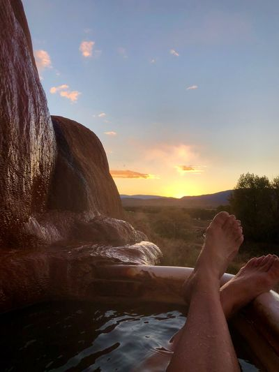 Total Relaxation Sky Sunset Nature Cloud - Sky Low Section Water Scenics - Nature Relaxation Real People Human Body Part Beauty In Nature Sunlight One Person Tranquil Scene Human Leg Leisure Activity Body Part Lifestyles Personal Perspective Outdoors