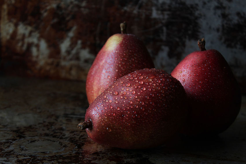 Beautiful food Red Pear Food And Drink Healthy Eating Freshness Fruit Wellbeing Close-up No People Red Still Life Focus On Foreground Wet Group Of Objects Ripe Raw Copy Space Dark Studio Shot Gourmet Agriculture Delicious Beautiful
