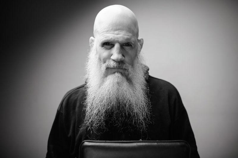 Portrait of senior man against gray background