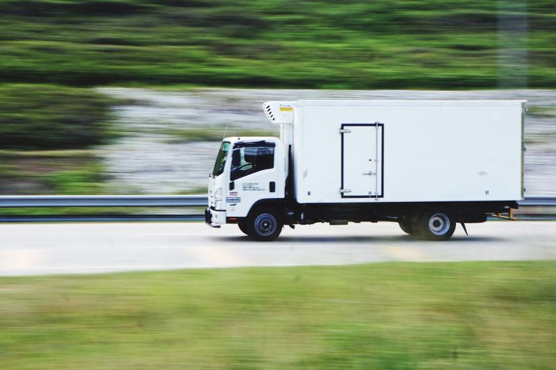 Panning shot of moving transport Motion Blurr Transportation Mode Of Transportation Land Vehicle Motion Blurred Motion Truck Green Color Day Road Travel Motor Vehicle Speed No People Semi-truck Commercial Land Vehicle