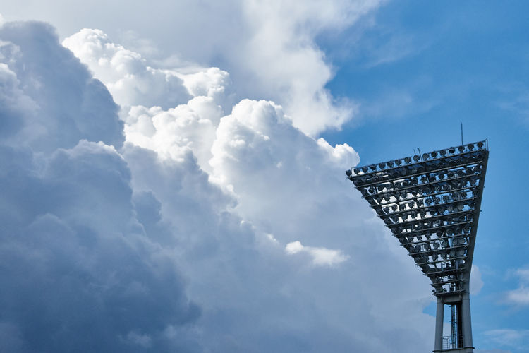 Low Angle View Of Floodlight Against Cloudy Sky