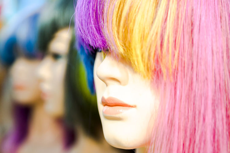 Close-up of woman with multi colored hair