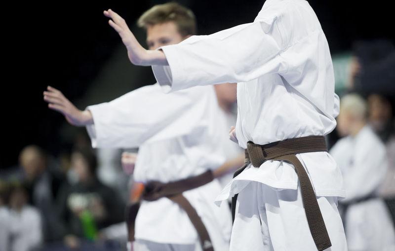 Karate men practicing in studio
