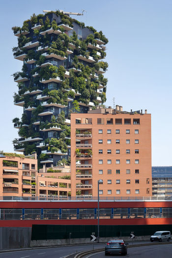 Milan, Italy - June 11, 2017: The famous Vertical Wood seen from Viale Luigi Sturzo. Sustainable residential building model, consisting of two residential towers of 110 and 76 m high, built in the center of Milan at the confines of the Isola district. Architecture Biodiversity Biodiversity Park Building Exterior Built Structure City Clear Sky Day Eco-sustainable Ecosystem  Environment Forest Green Innovative Microclimate No People Outdoors Reforestation Regeneration Residential Building Sky Tower Bridge  Tree Urban