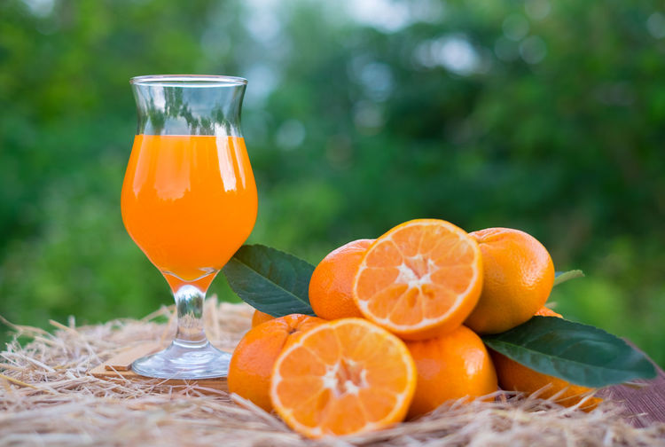 Close-Up Of Orange Juice On Table
