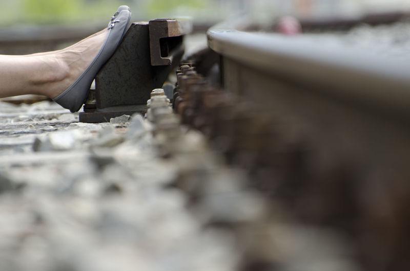Close-Up Of Leg On Railroad Track