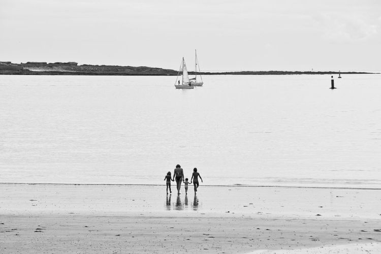 Beach Vacation Family Family At The Beach Blackandwhite Black & White Black And White Walking Into The Water Seaside Water