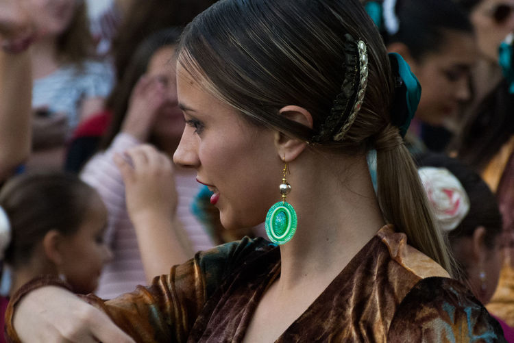 Close-up of woman looking away while dancing during festival