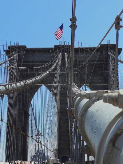 Architecture Bridge - Man Made Structure Built Structure Connection Day Flag Low Angle View No People Outdoors Patriotism Suspension Bridge