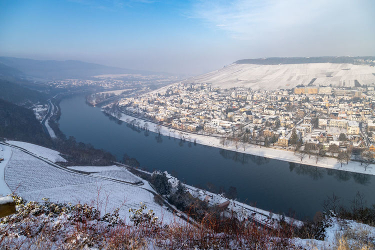 Scenic view of the river moselle valley and bernkastel-kues in winter with snow