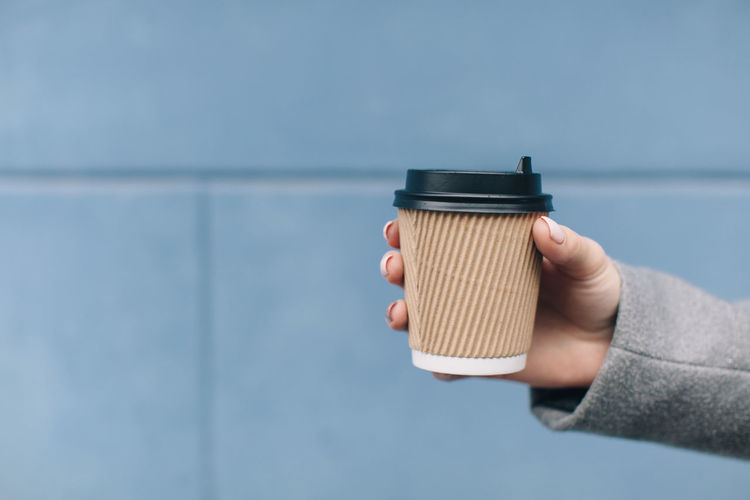 Background Close-up Coffee Cup Cup Day Focus On Foreground Holding Human Body Part Human Hand Lifestyles One Person Outdoor Outdoors People Real People Space Street Take Away Coffee