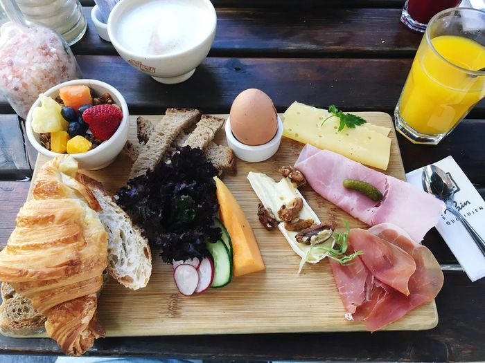 EyeEmNewHere Food And Drink Food Table Freshness High Angle View Still Life Healthy Eating Ready-to-eat Meal Meat Plate Egg Cutting Board Vegetable Wood - Material