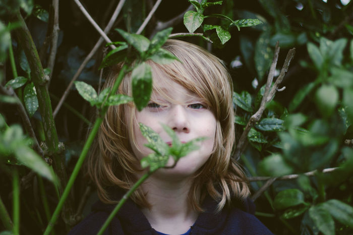 Little brother. Boy Youth Of Today Close-up Green Green Color Growth Innocence Leaf Person Plant Fine Art Photography The Portraitist - 2017 EyeEm Awards This Is Masculinity