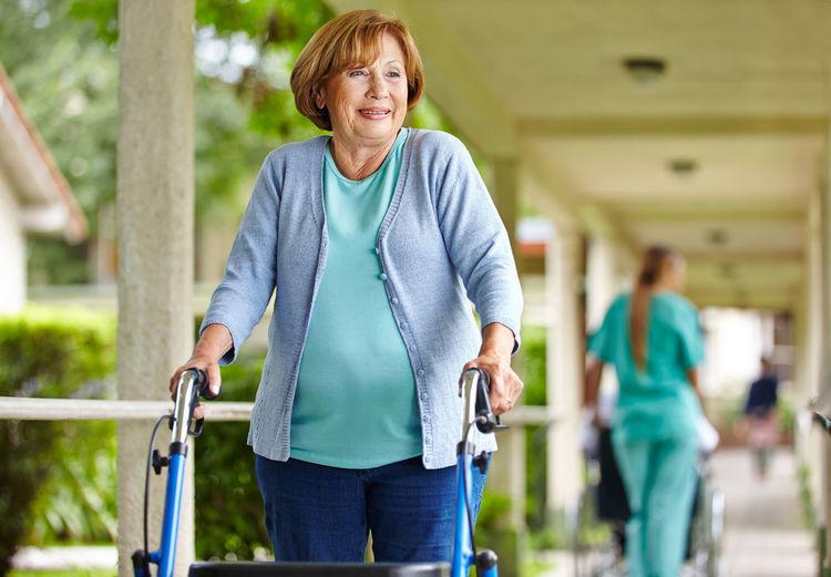 Smiling senior woman walking in corridor