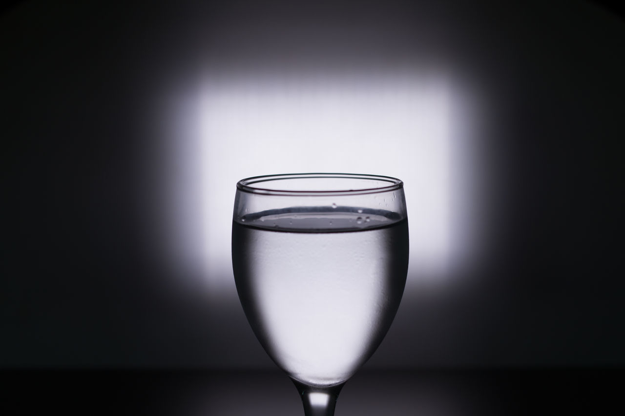 drinking glass, drink, refreshment, no people, indoors, alcohol, wineglass, food and drink, studio shot, table, close-up, wine, freshness, water, black background, day