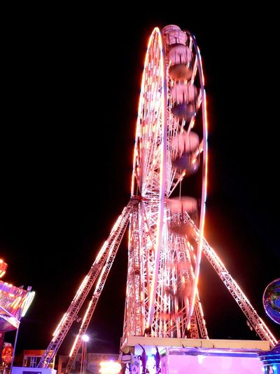 Faris Wheel Fairground Fairgrounds Fairground Ride Fairground Attraction Night Nightphotography Night Lights Night Photography Movement Fun Clear Sky Arts Culture And Entertainment Entertainment Millennial Pink Neon Life