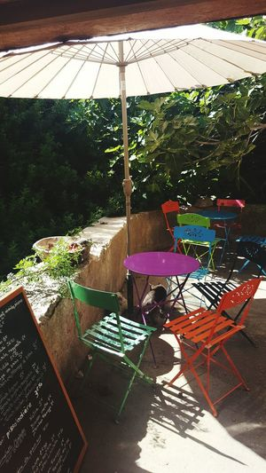 Relaxing Refreshing :) Colorful Calmness Perfect Day Corsica Parasol Bonifacio Hidden Gems  Hidden Places Beautiful Decoration Chairs And Tables My Favorite Place