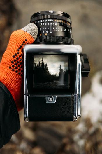Looking down at viewfinder of vintage hasselblad 500cm camera.