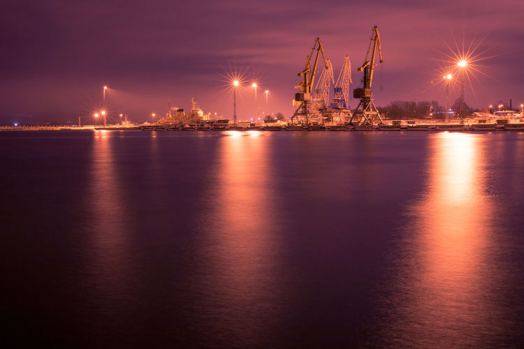 Water Night Illuminated Reflection Industry Sea Machinery Architecture Crane - Construction Machinery Transportation Harbor Freight Transportation Shipping  Business Ship Nature Sky No People Commercial Dock Outdoors Construction Equipment