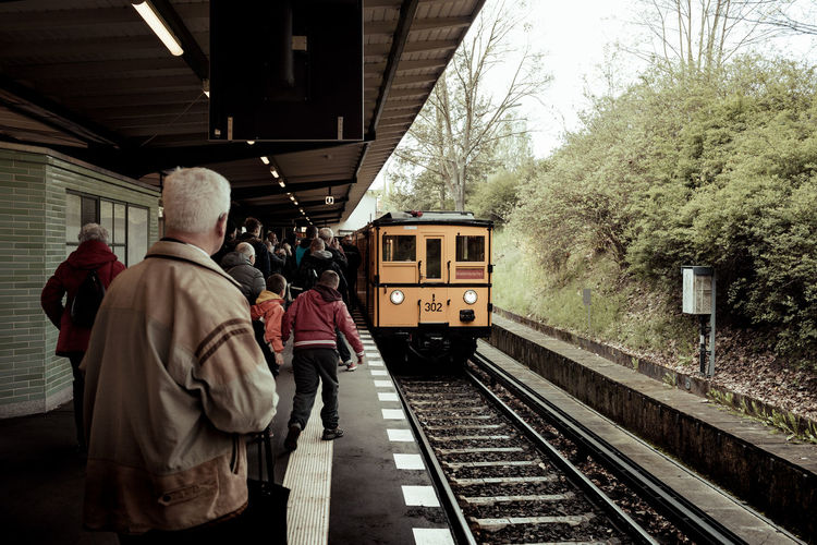 Rear view of people at railroad station