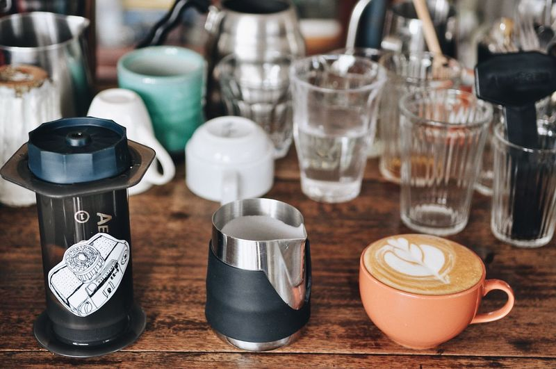 Aeropress Slowbar Hotcoffee Latteart Coffee Table No People Still Life Indoors  Wood - Material Choice Container Cup Drink Mug Coffee Glass Glass - Material Art And Craft