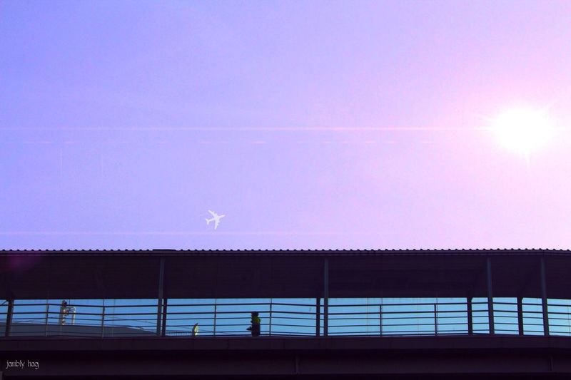 Low Angle View Of Silhouette Elevated Walkway Against Sky During Sunset