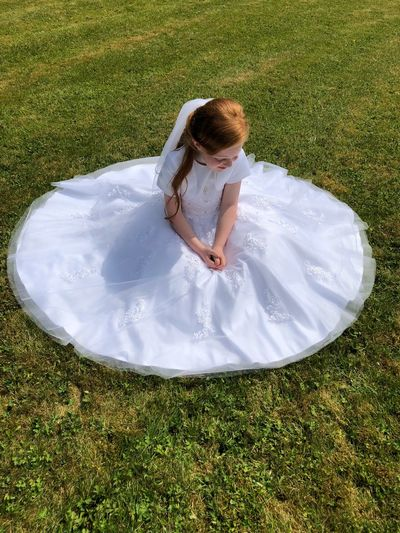 Sitting Alone Sitting Outside Prayerful Ginger Hair White Dress First Holy Communion Childhood Child High Angle View Grass Real People One Person Leisure Activity Day Innocence Outdoors