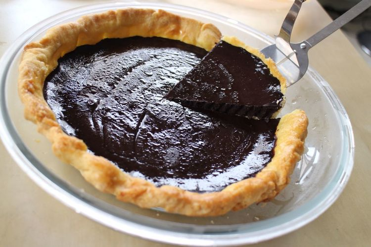 Close-Up Of Chocolate Tart Served On Table