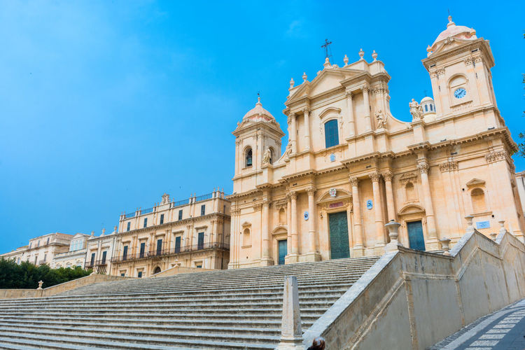 Noto Noto Peninsula Noto, Sicily Architecture Belief Blue Building Building Exterior Built Structure City Day History Low Angle View Nature No People Noto,sicily Place Of Worship Religion Sky Spirituality The Past Travel Travel Destinations