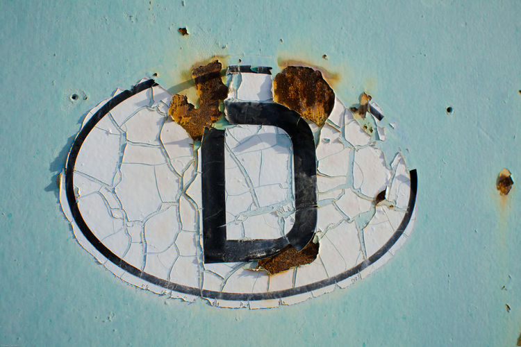 Close-up of letter d on wall
