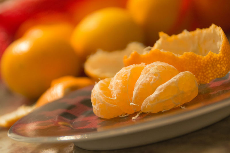 Close-Up Of Oranges In Plate