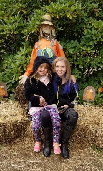 young woman with child Full Length Smiling Sitting Togetherness Portrait Happiness Friendship Childhood Women Child Scarecrow Posing