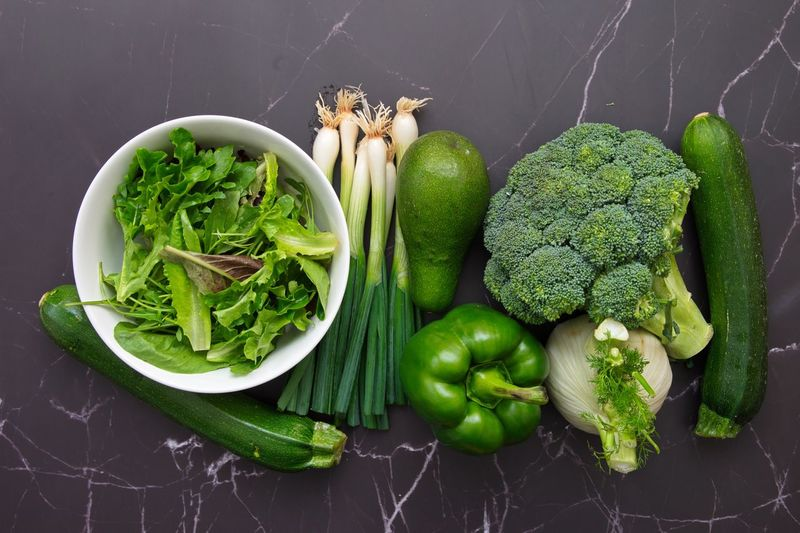 High angle view of vegetables and leaves on table