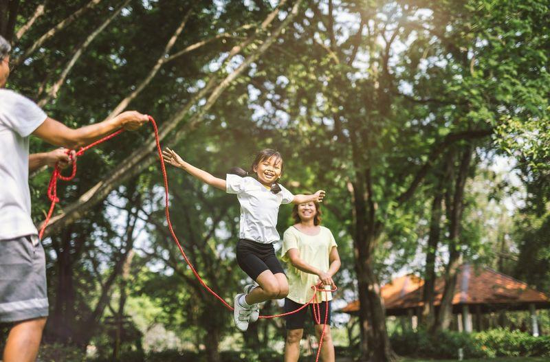 Cheerful Girl Skipping At Park
