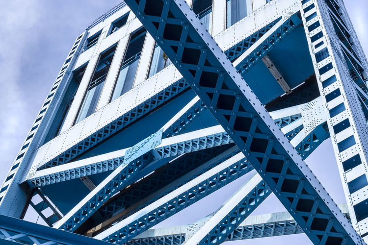 blue bridge Architecture Blue Bridge Bridge - Man Made Structure Bridges Building Exterior Built Structure City City Day Low Angle View Metalwork Modern Outdoors Sky And Clouds Tadaa Community