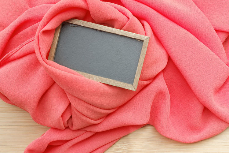 Hijab or cloth with black signage Blank Copy Space Copyspace Board Signage Hijab Cloth Soft Females Red Summer Textile Wood - Material Single Object Close-up Frame