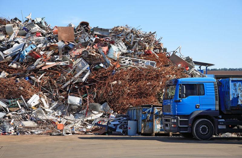 Truck Against Scrap Metals At Junkyard