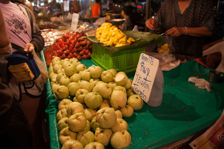Fresh cashew and guava fruits for sale at market stall