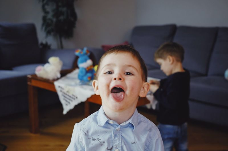EyeEm Selects Childhood Child Males  Indoors  Men Focus On Foreground Mouth Boys Portrait Mouth Open Home Interior Family