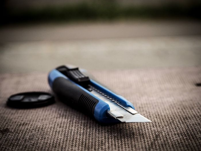 Close-up of utility knife on table