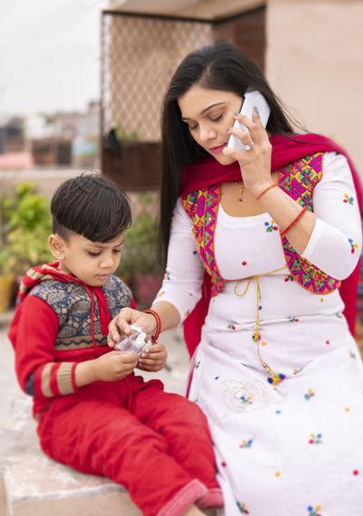 Full length of woman holding mobile phone