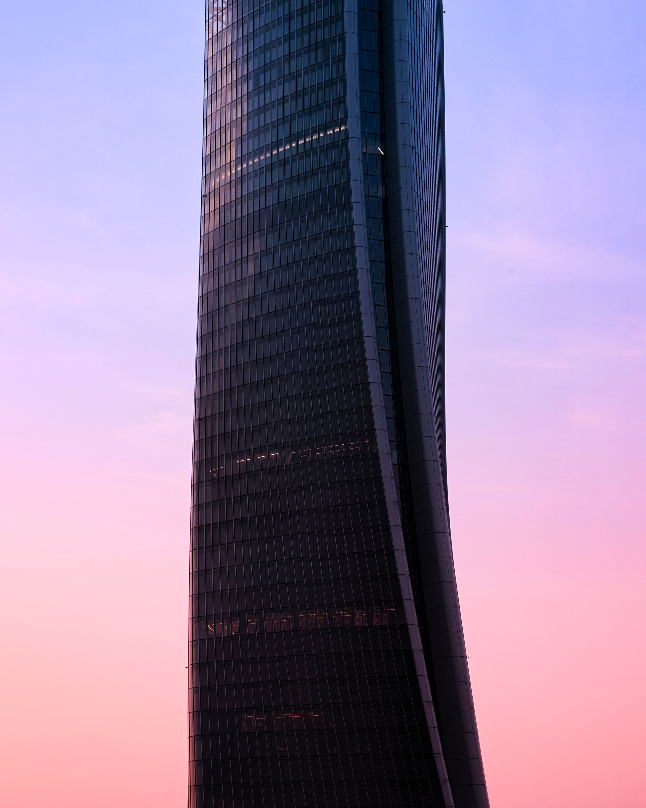 sky, sunset, built structure, modern, office building exterior, architecture, tall - high, low angle view, building exterior, skyscraper, city, nature, tower, office, no people, pink color, building, reflection, outdoors, travel destinations, purple