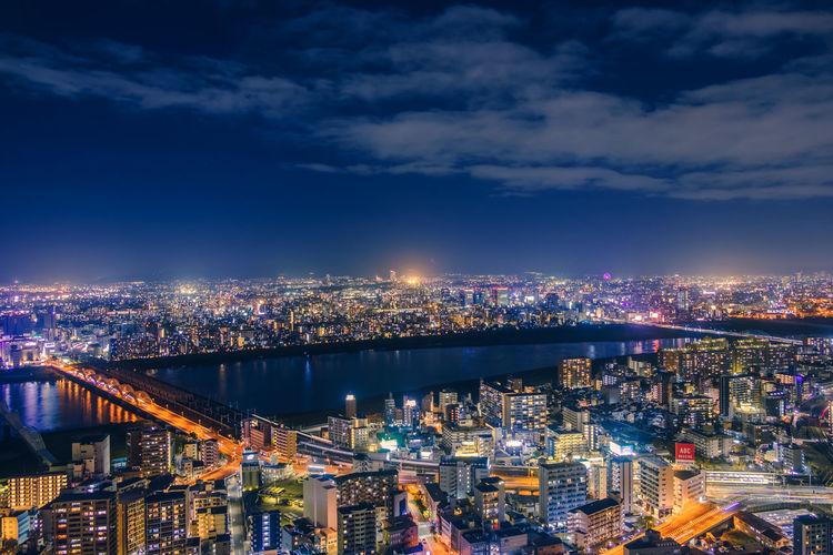 High angle view of illuminated osaka city buildings against sky at night